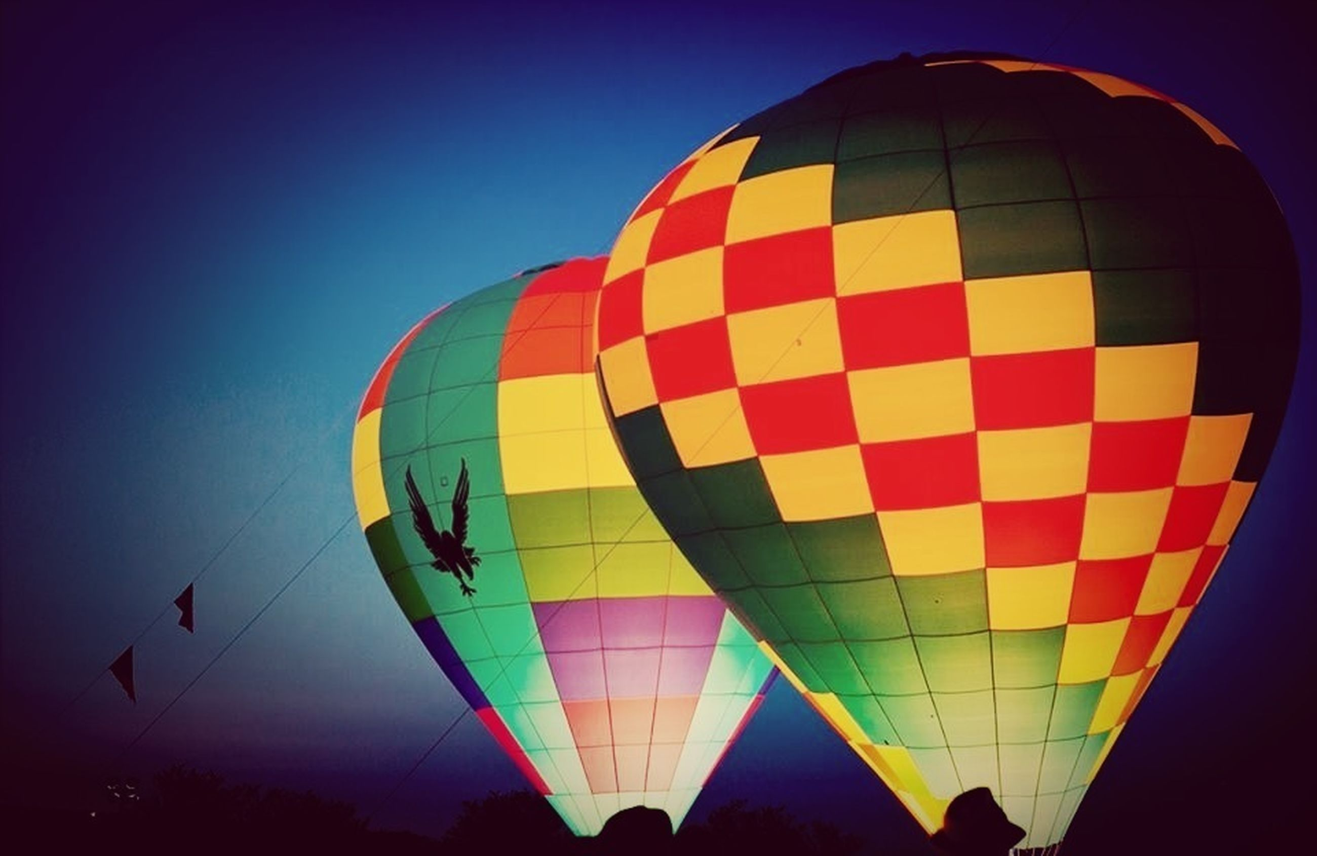 low angle view, multi colored, hot air balloon, mid-air, flying, sky, clear sky, arts culture and entertainment, pattern, fun, colorful, blue, amusement park, balloon, parachute, ferris wheel, outdoors, amusement park ride, copy space, adventure