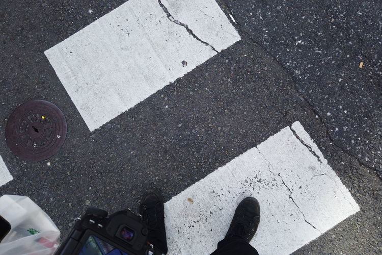 Urban Winter Street City Legs POV Looking Down Personal Perspective Minimalism Simplicity Human Leg Low Section Body Part Human Body Part One Person Shoe Real People High Angle View Day Standing Lifestyles Unrecognizable Person Outdoors Human Foot Human Limb Road Transportation Road Marking Sign