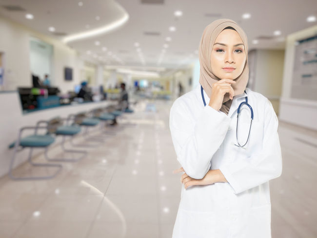 Adult Clothing Doctor  Focus On Foreground Front View Healthcare And Medicine Hospital Indoors  Lab Coat Medical Equipment Medical Instrument Medical Supplies Occupation One Person Real People Responsibility Standing Stethoscope  Uniform Women Young Adult