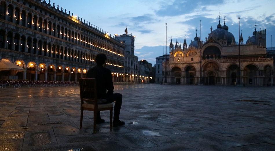 Man walking on bench in city