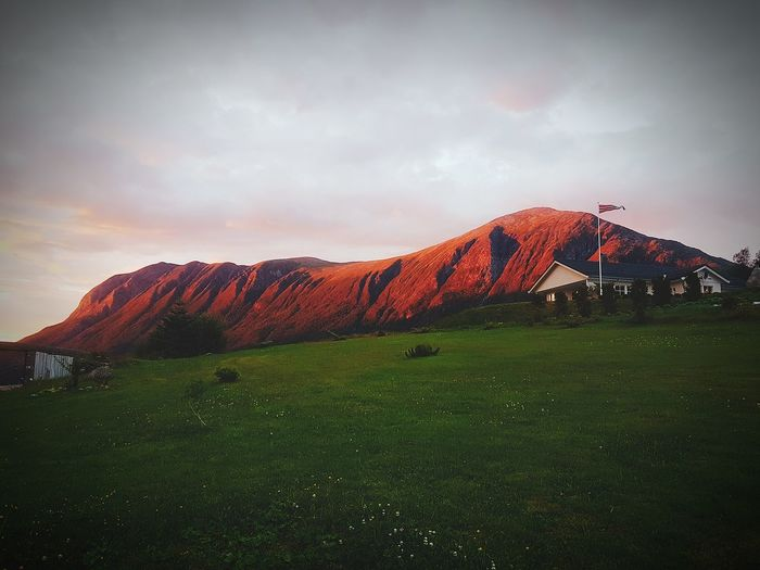 Landscape Beauty In Nature Sunset Mountain Outdoors Ancient Travel Destinations Cloud - Sky Nature Scenics Grass No People Rural Scene Day Redmountain Tustna Norway Spectacular Special Peaceful Brutalism Beauty In Nature Home Beautiful Mountain Range