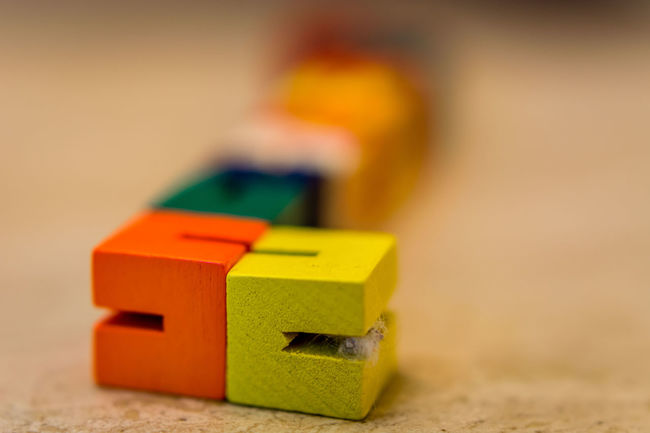 Blocks Brick Childs Toy Close-up Colorful Colour Cute Depth Of Field Detail Focus On Foreground Indoors  Multi Colored Old-fashioned Selective Focus Single Object Still Life Table Toy