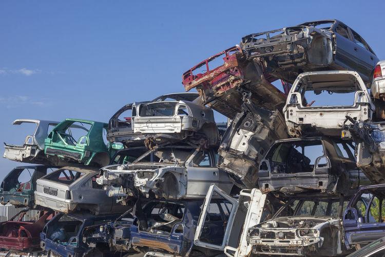 Abandoned Cars In Junkyard Against Sky