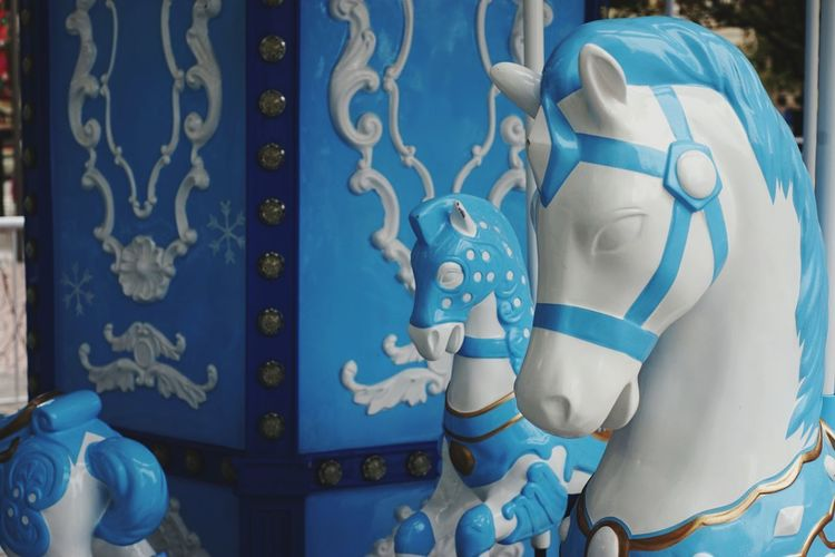 Close-up of sculpture against blue wall