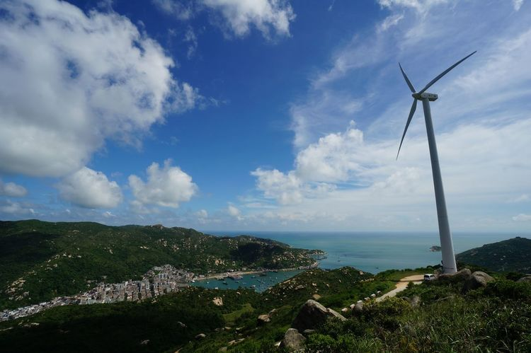 EyeEmNewHere Environment Sky Environmental Conservation Renewable Energy Wind Turbine Cloud - Sky Scenics - Nature Wind Power Beauty In Nature Alternative Energy Nature Landscape Sea Day Land Mountain No People Outdoors Wind Power In Nature Shangchuan Island Guangdong Shadi