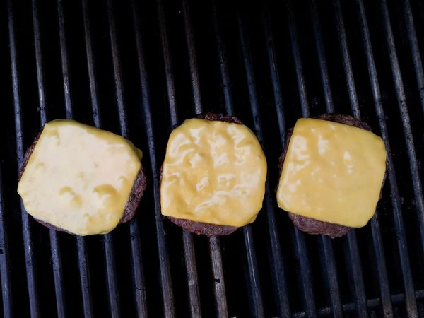 Three cheese burgers on the grill Burgers Cheeseburgers CheeseBurger In My Mouf Grilled Meat Grilling Grilled BBQ Food Foodphotography Three Hamburger Cheesebuger Grill Meat! Meat! Meat! Barbecue Grilling Out Summer Dinner Food Photography From Above  Yum Foodie LetsEat Picnic