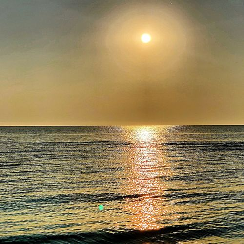 Water Sky Sea Horizon Over Water Horizon Beauty In Nature Sunset Sun Scenics - Nature Nature Tranquility Sunlight Tranquil Scene No People Idyllic Orange Color Outdoors Reflection Land Digital Composite