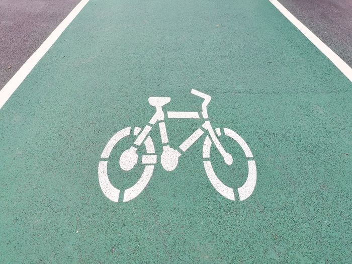 High angle view of bicycle lane sign on road