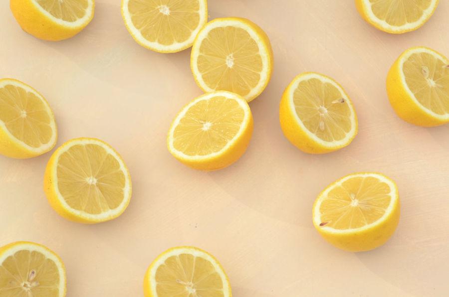 freshly cut lemon halves Citrus Fruit Close-up Cross Section Day Directly Above Food Background Food Styling Fresh Produce Freshness Fruit Halved Healthy Eating Juicy Lemon Lemons No People Raw Food SLICE Sour Taste Yellow