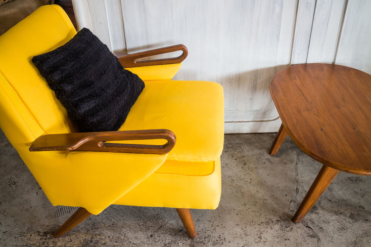 High angle view of yellow chair at home