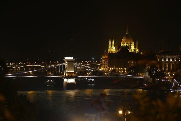 The Chain Bridge with the Parliament in the background on a summer night, at Budapest, Hungary Budapest Danube Downtown Elisabeth Bridge Hungary Architecture Bridge Bridge - Man Made Structure Built Structure Chain Bridge City Connection Illuminated Night No People Outdoors Parliament River Tourism Transportation Travel Travel Destinations Water Waterfront