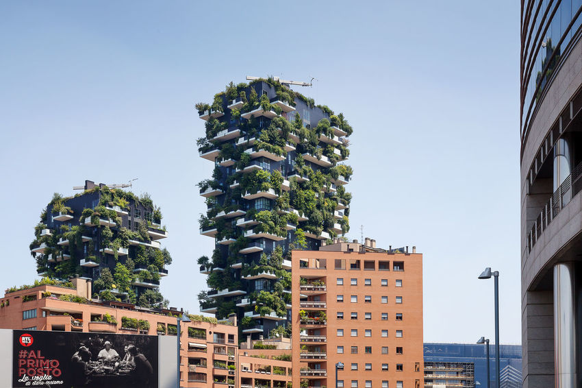 Milan, Italy - June 11, 2017: The famous Vertical Wood seen from Viale Luigi Sturzo. Sustainable residential building model, consisting of two residential towers of 110 and 76 m high, built in the center of Milan at the confines of the Isola district. Architecture Biodiversity Building Exterior Built Structure City Clear Sky Day Eco-sustainable Forest Low Angle View No People Outdoors Residential Building Sky Tower Bridge  Tree