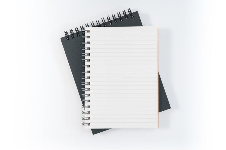 Spiral Notebook White Background Spiral Education Note Pad Studio Shot Copy Space Publication Indoors  Book Paper No People Open Pen White Color Blank Page Cut Out Still Life High Angle View Ring Binder Message Studying