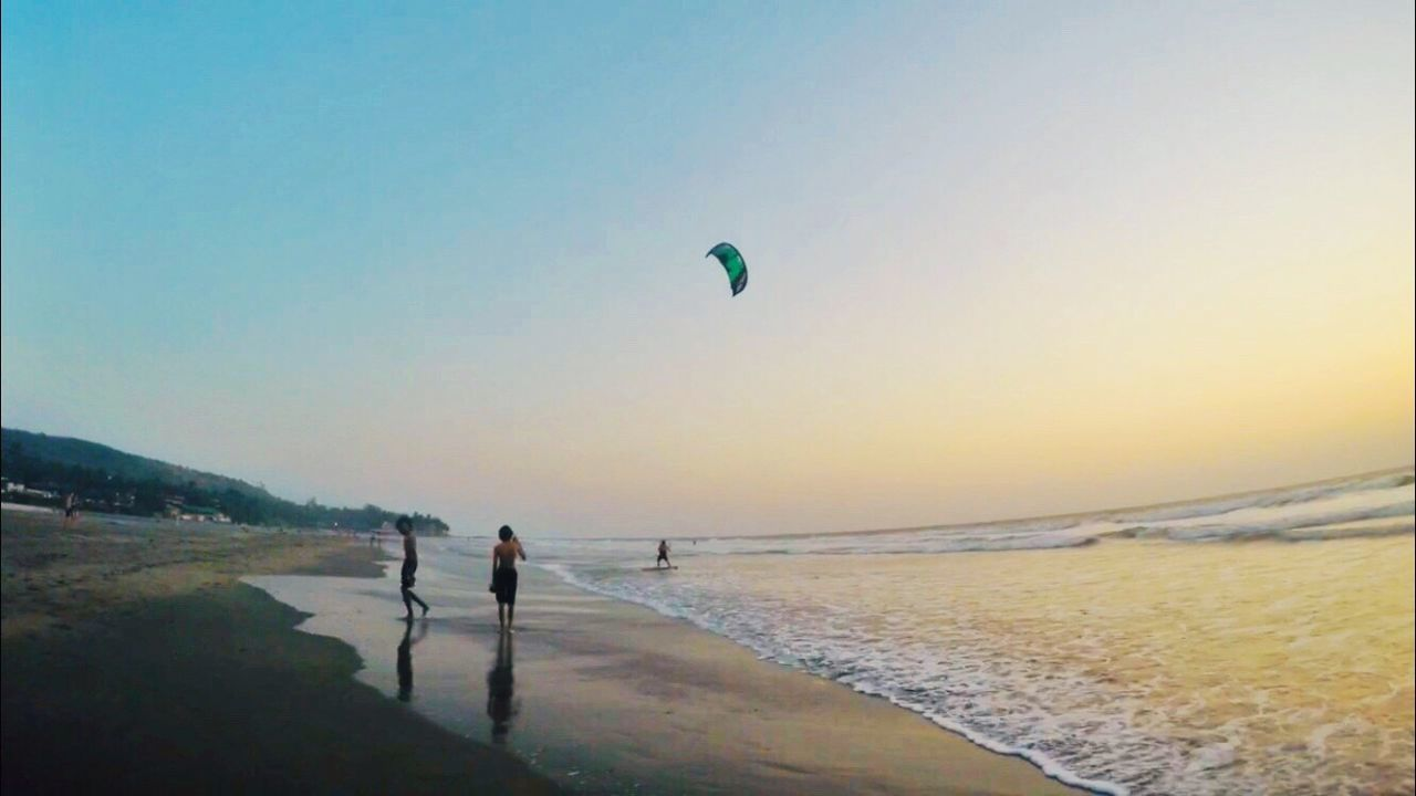 sky, sea, water, real people, leisure activity, lifestyles, beach, sport, beauty in nature, land, nature, trip, vacations, adventure, holiday, people, sunset, unrecognizable person, clear sky, horizon over water, outdoors