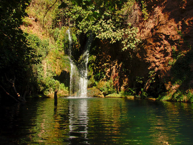 Idyllic Huesna waterfall in San Nicolas Del Puerto, Sierra Norte de Sevilla Natural Park , Andalucia Spain Andalusia Nature Reflection San Nicolas Del Puerto Spain🇪🇸 Spanish Moss Andaluciaviva Beauty In Nature Countryside Day Flowing Water Forest Lake Landscape Motion Nature Reflections Reflections In The Water Tourism Tranquil Scene Tranquility Water Waterfall Waterfront