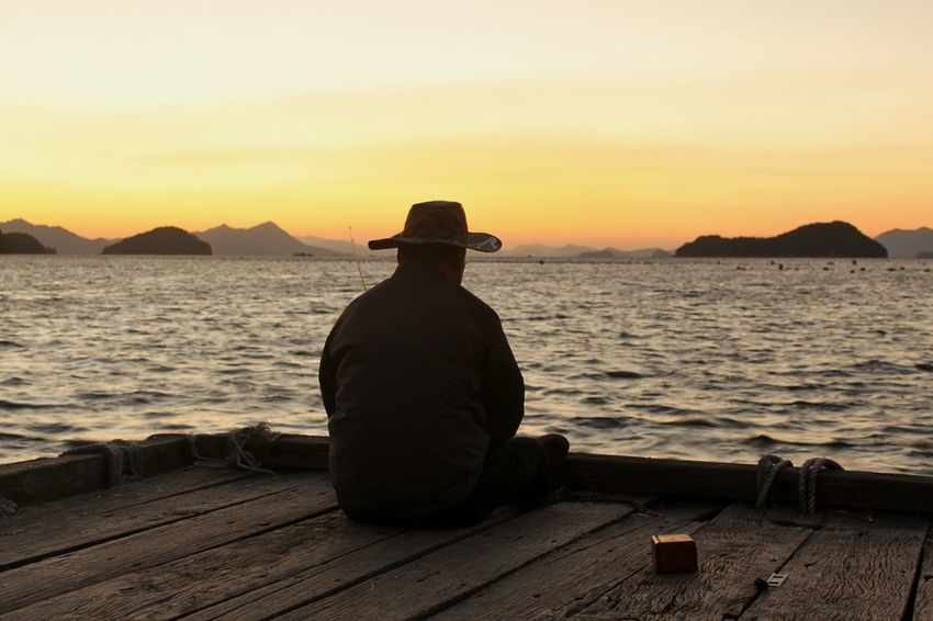 Beautiful sunset while waiting for the bait. Tongyeong, Korea Glorious Sunset Fishing Following Silhouette Man With Hat Mountain Silhouette Orange Sun Lake Sunset With Structure In Silhouette. Feel The Journey Original Experiences 43 Golden Moments Long Goodbye
