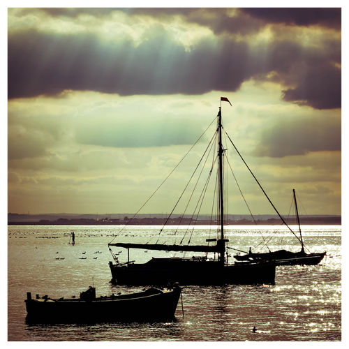 3 Boats Beauty In Nature Boat Calm Cloud - Sky Cloudy Dramatic Sky Estuary Horizon Over Water Idyllic Leigh On Sea Mast Mode Of Transport Nature Nautical Vessel Paddle Boarder River Thames Sailboat Sea Sillouette Sillouettes Of Boats Sky Sunset Tranquility Water