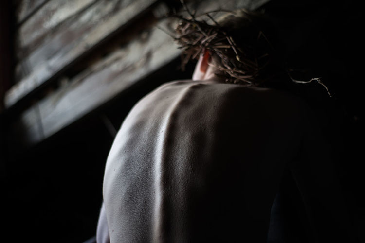 One Person Indoors  Real People Lifestyles Men Body Part Young Adult Young Skin Mood Depression - Sadness Depression Depressive Rear View Adult Human Body Part Shirtless Focus On Foreground Black Background