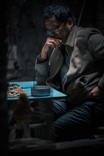 Adult Adults Only Arts Culture And Entertainment Chess China Chongqing Indoors  Local Men Music Night One Man Only One Person Only Men People Real People Teahouse