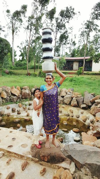 Tribal Habitat Museum Araku Valley Vishakapatnam - statue of a tribal woman carrying series of aluminium pots on her head. The little girl is my daughter posing with statue 😀 Check This Out Hello World Enjoying Life Statues And Monuments Statue Arakuvalley Araku Vishakapatnam Woman Statue Tribe Tribal Costume Tribal Culture Museum Visit Museum Artistic Artistic Expression Girl Photography Girl
