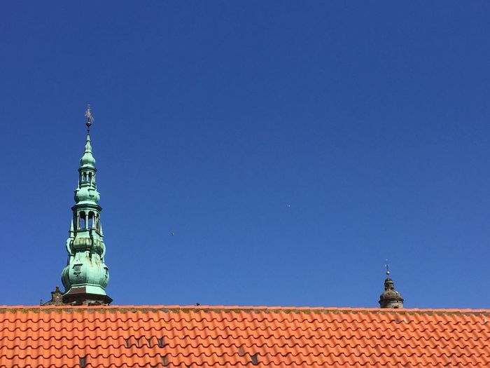 Low angle view of kronborg castle against clear blue sky