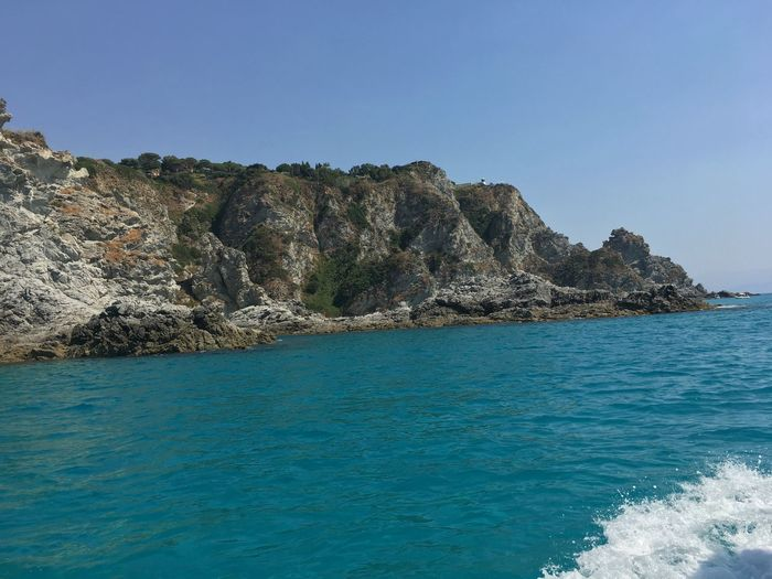 Photo Calabria Sea Nature Rock - Object Beauty In Nature Rock Formation Scenics Blue Water Tranquility No People Outdoors Waterfront Clear Sky Sky