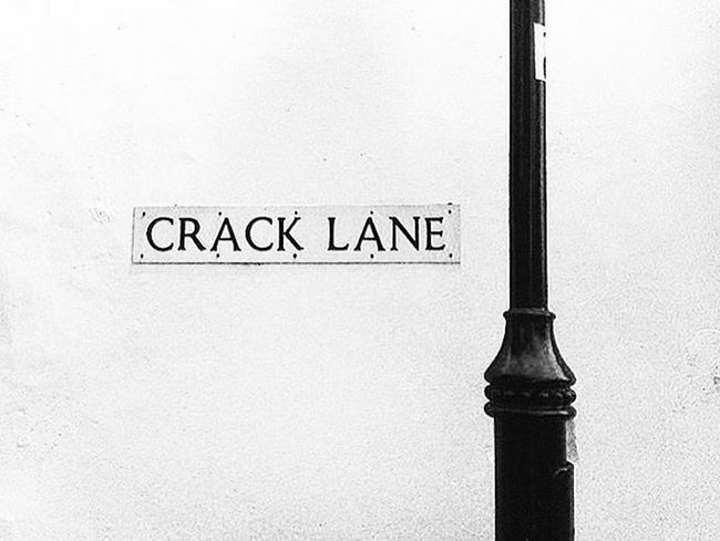 Sign Black And White Close-up Communication Crack Lane Day Lampost Lane Night Walk Around The Town No People Outdoors Street Sign Text Village Lane