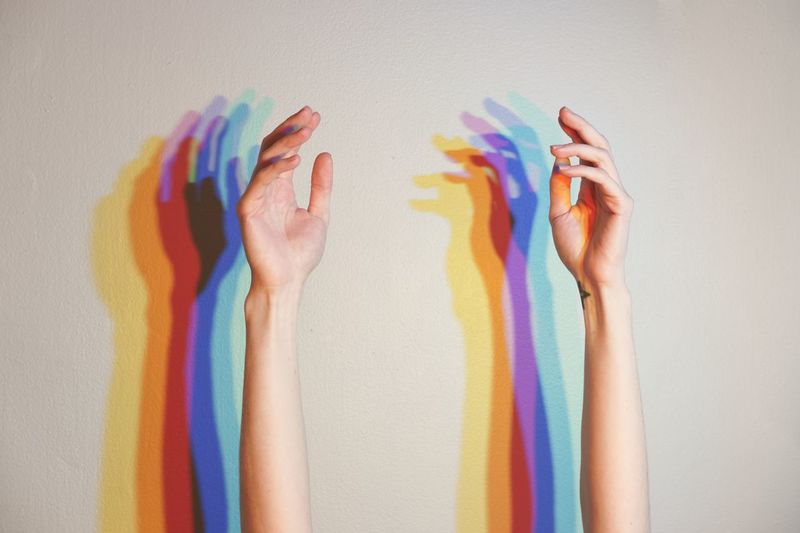 Roller coaster Multi Colored Human Body Part Body Part One Person Hand Human Hand Indoors  Studio Shot Creativity Human Arm Women Limb Vibrant Color Rainbow