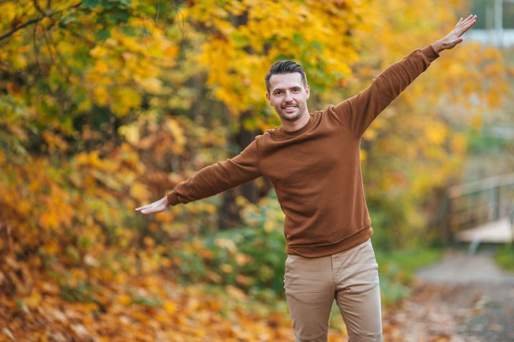 Full length of young man standing in park during autumn