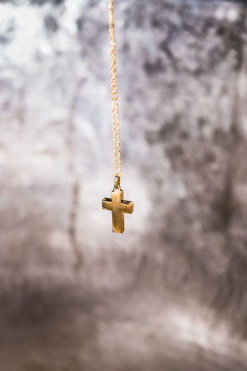 Cross Architecture Baptism Belief Close-up Cloud - Sky Communication Cross Day Focus On Foreground Gold Colored Hanging Jewlery Low Angle View Metal Nature No People Outdoors Pattern Religion Selective Focus Single Object Sky