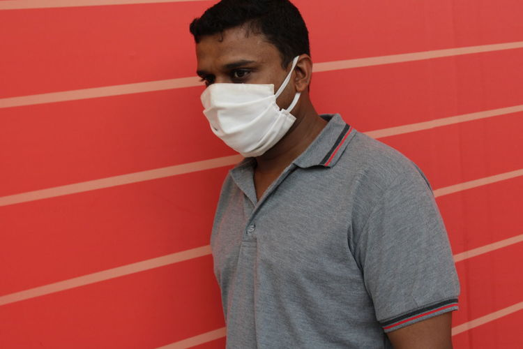 Man of asian ethnicity with face mask