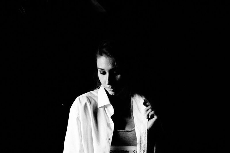 Thoughtful Young Woman In Darkroom