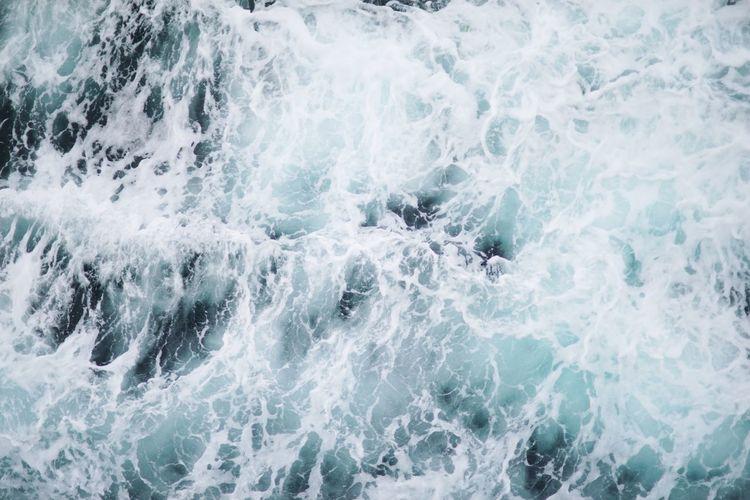 Close-up of waves splashing in sea