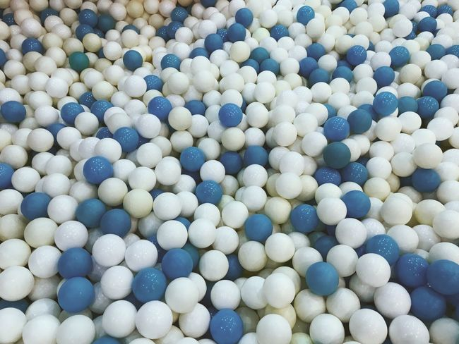 Plastic balls in blue and white Blue Balls Plastic Backgrounds Abundance No People Blue Large Group Of Objects Day High Angle View Pattern Abstract Close-up White Color Multi Colored Still Life Textured