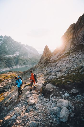 Sunset hikes Sunset Switzerland Mountain Range Lens Flare Non-urban Scene People Leisure Activity Rear View Day Hiking Group Of People Scenics - Nature Winter Walking Outdoors