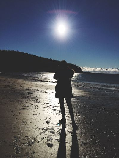 Silhouette of woman standing on beach