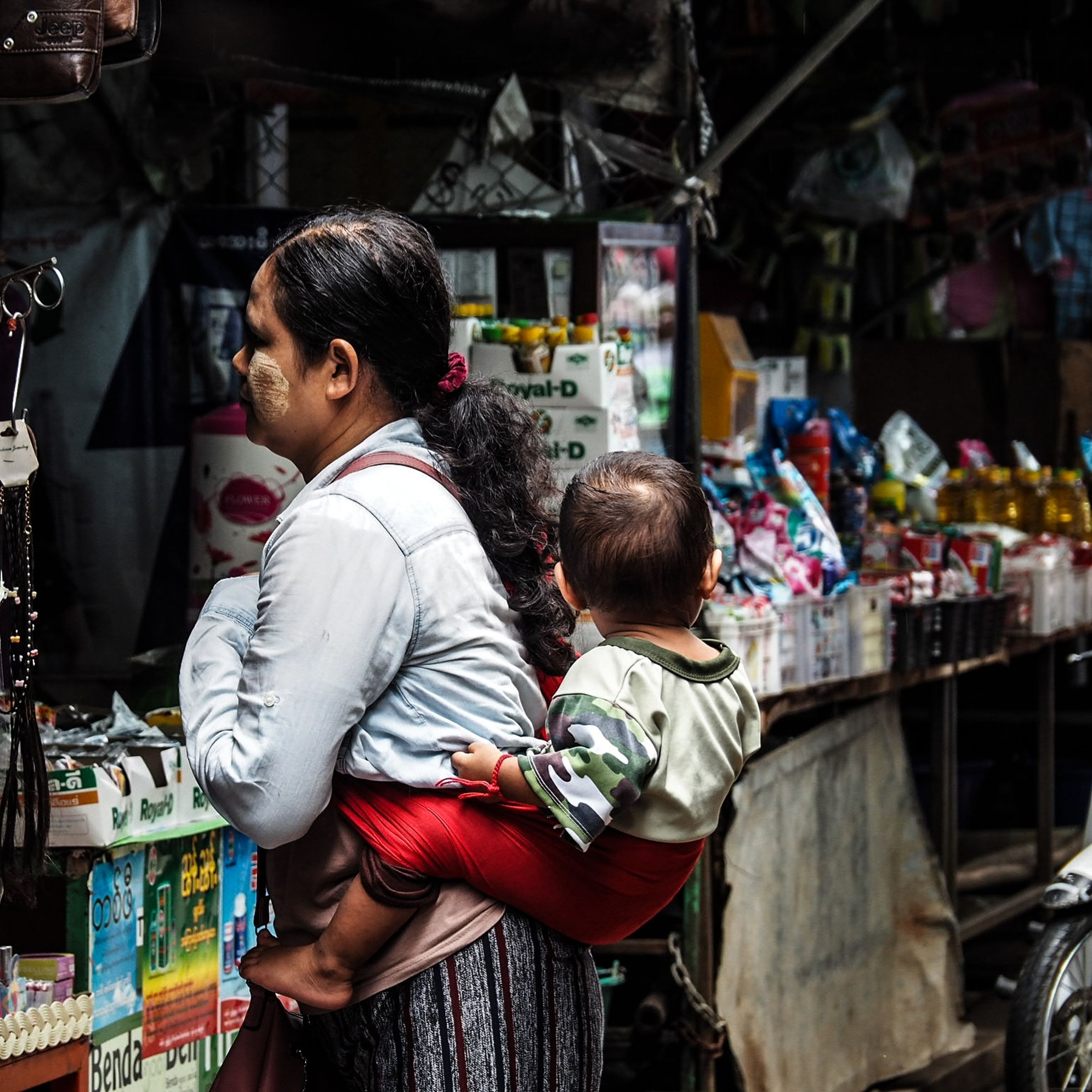 real people, men, lifestyles, two people, women, standing, casual clothing, three quarter length, retail, rear view, market, child, business, childhood, store, market stall, choice, shopping, leisure activity, people, buying, retail display, positive emotion, hairstyle, son
