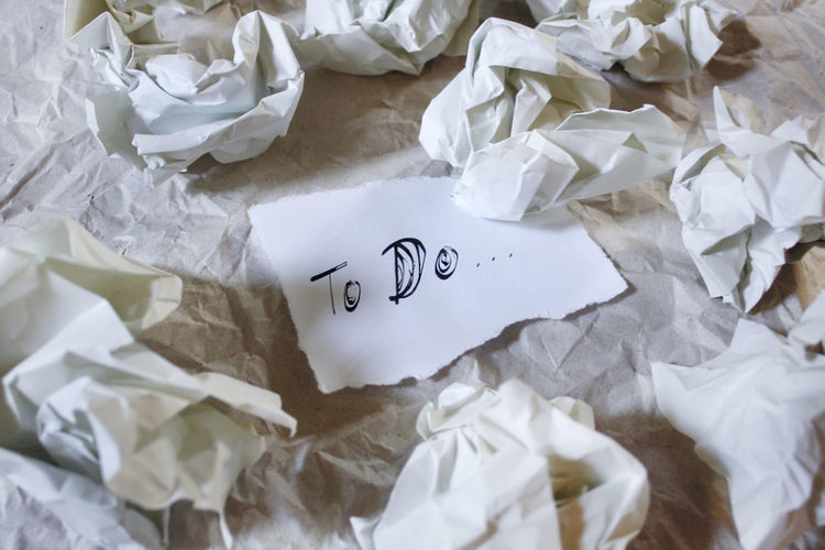 High angle view of to do text by crumpled paper on table