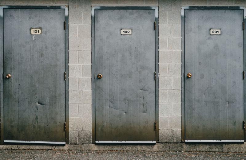 Three metal doors in a row.