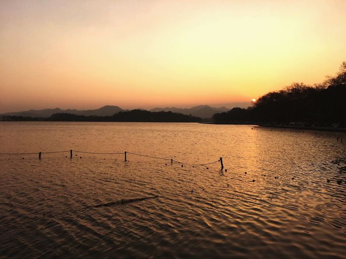 Finding New Frontiers Sunset Mountain Outdoors Water Scenics Beauty In Nature Nature The West Lake West Lake Hangzhou The Great Outdoors - 2018 EyeEm Awards