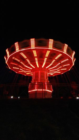 Lights In The Dark Red Light Trails Hypnotic Night Life Family Time Summertime Amusement Ride Swings Magical