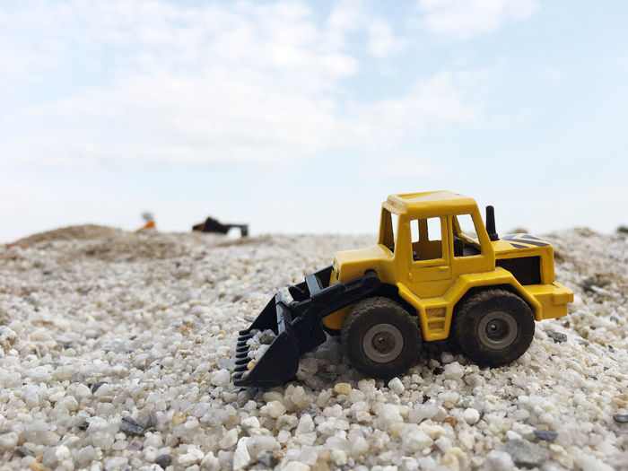 Toy earth mover on stones