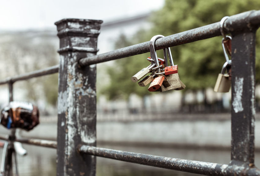 Bridge Close-up Day Focus On Foreground Hanging Hope Lock Locked In Love Lockers Love Love Lock Metal Nature No People Outdoors Padlock Protection Railing Safety Security Symbolic Love Water