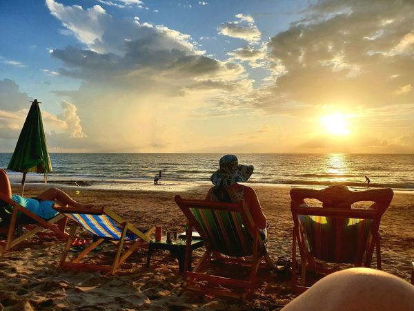 Back of Woman with sun hat and man sitting in sun chair watching sunset of dramatic cloudy sky at khlong Nin Beach, Ko Lanta, Thailand. ... Sunset Sunset_collection Sunset Silhouettes Sunset #sun #clouds #skylovers #sky #nature #beautifulinnature #naturalbeauty #photography #landscape Travel Wanderlust Postcard People Travel Destinations People Watching Water Sea Sunset Beach Sand Summer Chair Sunlight Relaxation Backgrounds Seascape Coastline Wave Calm Coast Shore Sandy Beach Coastal Feature Horizon Over Water Ocean
