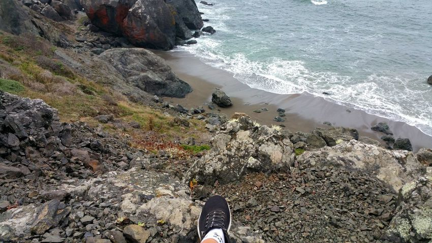 My sitting and thinking spot. Red Boulders Thinking Spot Thinking Contemplating Foot Sneaker Zen Atmospheric Moody Solitude Water Wave Sea Beach Sand High Angle View Low Section Shore Rock - Object Rushing Surf Coast Crashing Tide Rock Boulder Stone Rugged Seascape