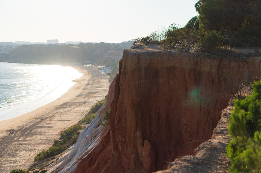 Algarve Red Coast Beach Beauty In Nature Cliff Day Eroded Land Nature No People Outdoors Plant Real People Rock Rock - Object Rock Formation Scenics - Nature Sea Sky Solid Tranquil Scene Tranquility Tree Water