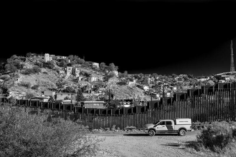 United States - Mexico border fence in Nogales, Arizona Arizona Black And White Black And White Photography Border Border Patrol Border Patrol HOMELAND SECURITY Illegal Immigration Mexico Nogales Politics Politics And Government Us Mexico Border USA Wall