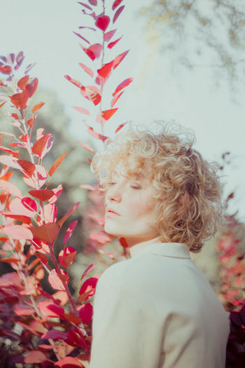 Beauty In Nature Blond Hair Boys Childhood Close-up Day Elementary Age Flower Focus On Foreground Girls Growth Leisure Activity Lifestyles Nature One Person Outdoors People Plant Real People Red Side View The Portraitist - 2017 EyeEm Awards Young Adult Young Women
