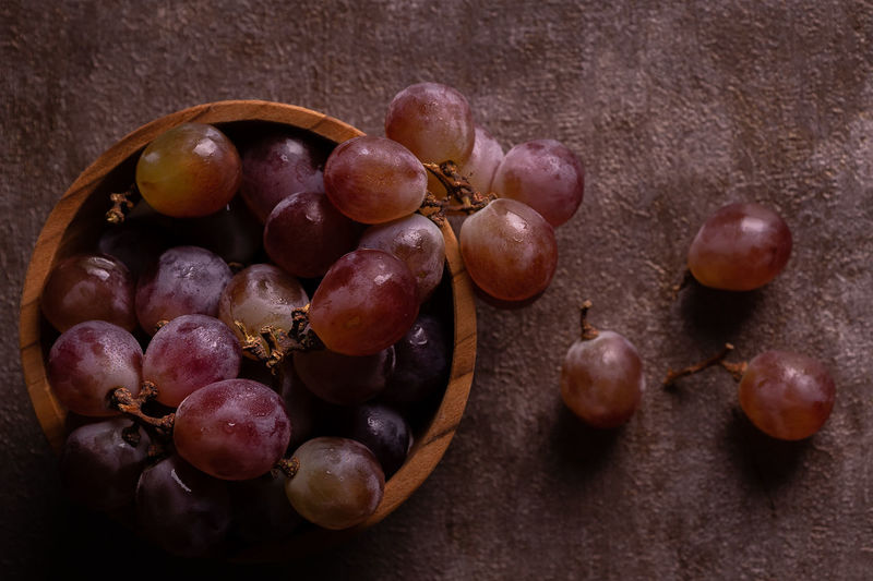 High angle view of grapes on table