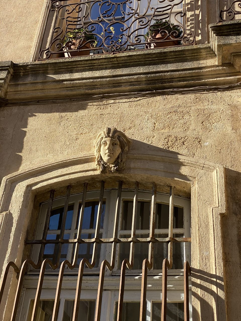 built structure, architecture, building exterior, low angle view, building, window, no people, day, representation, sculpture, history, the past, human representation, statue, old, art and craft, outdoors, male likeness, balcony, wall - building feature, architectural column, ornate